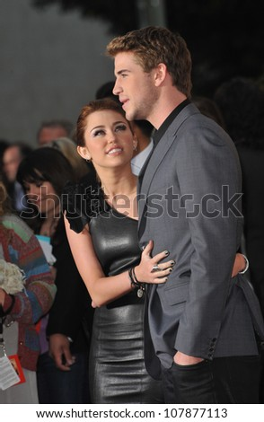 """LOS ANGELES, CA - MARCH 25, 2010: Miley Cyrus & Liam Hemsworth at the world premiere of their new movie """"The Last Song"""" at the Arclight Theatre, Hollywood. - stock photo"""