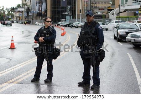 LOS ANGELES,CA - MARCH 02: Police officers on the street during Academy Awards on march 02, 2014 in Los Angeles, CA. - stock photo