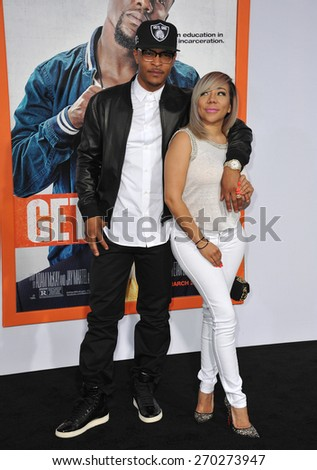 "LOS ANGELES, CA - MARCH 25, 2015: Tip ""T.I."" Harris & wife Tameka ""Tiny"" Cottle at the Los Angeles premiere of his movie ""Get Hard"" at the TCL Chinese Theatre, Hollywood.  - stock photo"