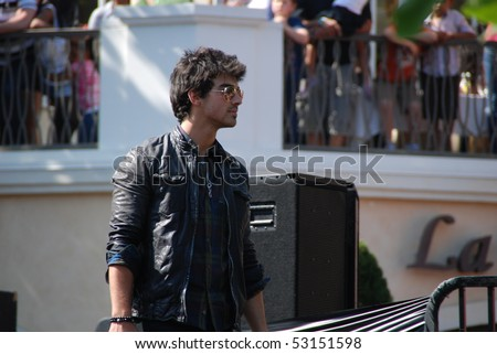 LOS ANGELES, CA- MAY 15: Joe Jonas performs at The Jonas Brothers summer tour kickoff at The Grove on May 15, 2010 in Los Angeles, California. - stock photo