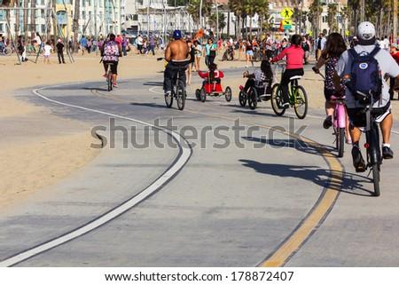 LOS ANGELES, CA -  MAY 27, 2013: People riding bicycles on Santa Monica Bike Path - stock photo