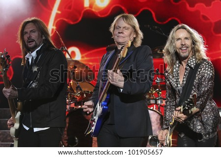 LOS ANGELES, CA - MAY 06: Ricky Phillips, James Young and Tommy Shaw of Styx perform at the Greek Theatre on May 6, 2012 in Los Angeles, CA. - stock photo