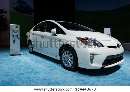 LOS ANGELES, CA - NOVEMBER 20: A Toyota Prius Plug-In on exhibit at the Los Angeles Auto Show in Los Angeles, CA on November 20, 2013 - stock photo