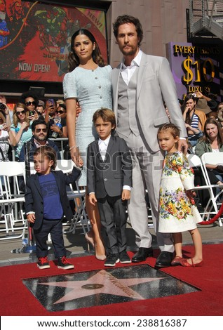LOS ANGELES, CA - NOVEMBER 17, 2014: Actor Matthew McConaughey & wife Camilla Alves & children on Hollywood Boulevard where he was honored with the 2,534th star on the Hollywood Walk of Fame.  - stock photo