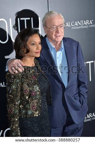 """LOS ANGELES, CA - NOVEMBER 17, 2015: Actor Michael Caine & wife Shakira at the Los Angeles premiere of his movie """"Youth"""" at the Directors Guild of America.  - stock photo"""