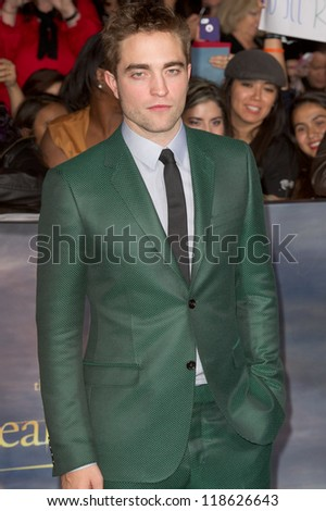 LOS ANGELES, CA - NOVEMBER 12: Actor Robert Pattinson arrives at the premiere of The Twilight Saga: Breaking Dawn - Part 2 at the Nokia Theater in Los Angeles, CA on November 12, 2012 - stock photo