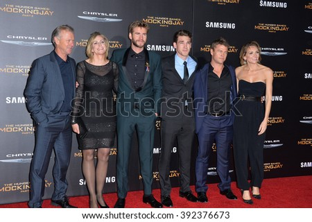"LOS ANGELES, CA - NOVEMBER 16, 2015: Actors Liam Hemsworth (3rd from left), Luke Hemsworth (2nd from right) & parents & family at the premiere of   Liam's movie ""The Hunger Games: Mockingjay - Part 2"" - stock photo"