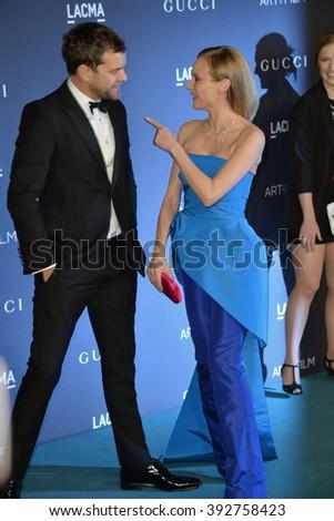 LOS ANGELES, CA - NOVEMBER 7, 2015: Actress Diane Kruger & actor husband Joshua Jackson at the 2015 LACMA Art+Film Gala at the Los Angeles County Museum of Art - stock photo