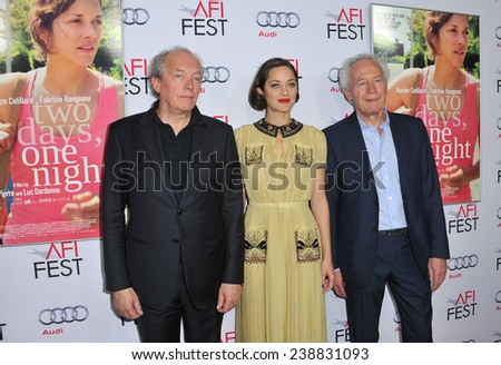 """LOS ANGELES, CA - NOVEMBER 7, 2014: Actress Marion Cotillard with directors Jean-Pierre Dardenne & Luc Dardenne at the AFI Fest premiere of """"Two Days, One Night"""" at the Egyptian Theatre, Hollywood.  - stock photo"""