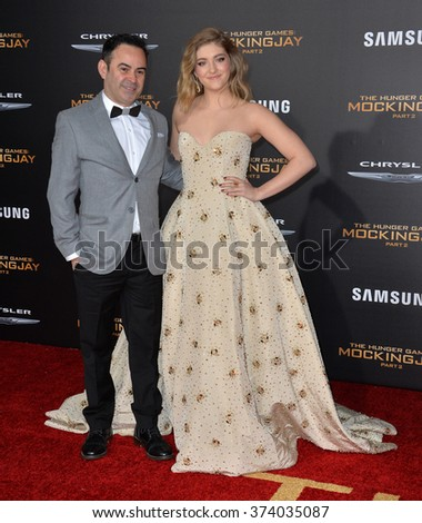 """LOS ANGELES, CA - NOVEMBER 16, 2015: Actress Willow Shields & actor/writer Nelson Ascencio at the Los Angeles premiere of """"The Hunger Games: Mockingjay - Part 2"""" at the Microsoft Theatre, LA Live.   - stock photo"""