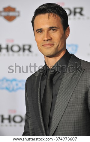 "LOS ANGELES, CA - NOVEMBER 4, 2013: Brett Dalton at the US premiere of ""Thor: The Dark World"" at the El Capitan Theatre, Hollywood. Picture: Paul Smith / Featureflash - stock photo"
