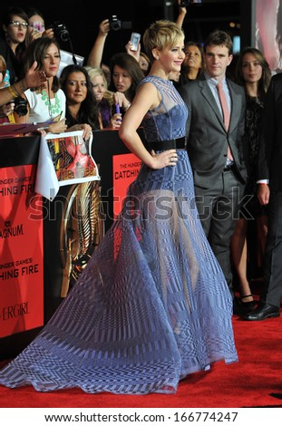 """LOS ANGELES, CA - NOVEMBER 18, 2013: Jennifer Lawrence at the US premiere of her movie """"The Hunger Games: Catching Fire"""" at the Nokia Theatre LA Live.  - stock photo"""