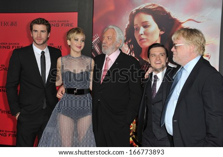 """LOS ANGELES, CA - NOVEMBER 18, 2013: Jennifer Lawrence, Liam Hemsworth (left), Donald Sutherland, Josh Hutcherson & Philip Seymour Hoffman at the premiere of """"The Hunger Games: Catching Fire"""".  - stock photo"""