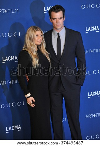 LOS ANGELES, CA - NOVEMBER 2, 2013: John Duhamel & wife Fergie, of the Black Eyed Peas, at the 2013 LACMA Art+Film Gala at the Los Angeles County Museum of Art.