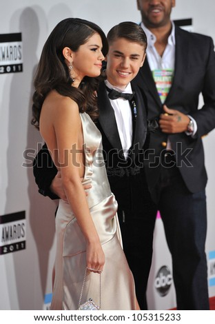 LOS ANGELES, CA - NOVEMBER 20, 2011: Justin Bieber & Selena Gomez at the 2011 American Music Awards at the Nokia Theatre, L.A. Live in downtown Los Angeles. November 20, 2011  Los Angeles, CA - stock photo