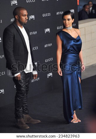 LOS ANGELES, CA - NOVEMBER 1, 2014: Kim Kardashian & Kanye West at the 2014 LACMA Art+Film Gala at the Los Angeles County Museum of Art.  - stock photo