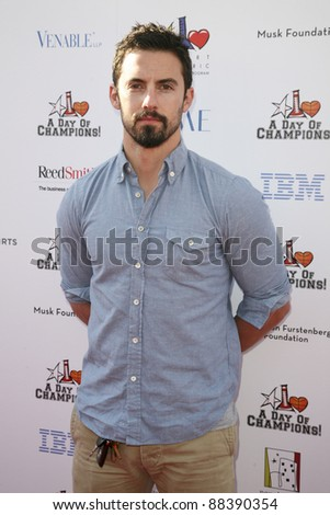 LOS ANGELES, CA - NOVEMBER 06: Milo Ventimiglia arrives at A Day Of Champions Benefiting the Bogart Pediatric Cancer Research Program at Sports Museum of Los Angeles on November 6, 2011. - stock photo