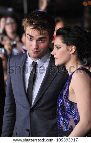 "LOS ANGELES, CA - NOVEMBER 14, 2011: Robert Pattinson & Kristen Stewart at the world premiere of ""The Twilight Saga: Breaking Dawn - Part 1"". November 14, 2011  Los Angeles, CA - stock photo"