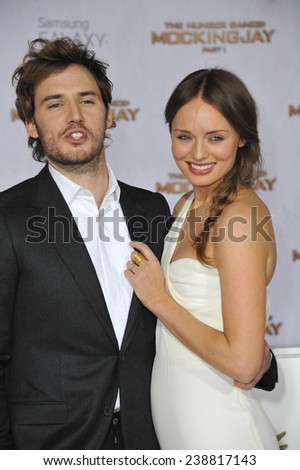 "LOS ANGELES, CA - NOVEMBER 17, 2014: Sam Claflin & wife Laura Haddock at the Los Angeles premiere of his movie ""The Hunger Games: Mockingjay Part One"" at the Nokia Theatre LA Live.  - stock photo"