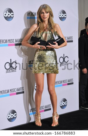 LOS ANGELES, CA - NOVEMBER 24, 2013: Taylor Swift in the pressroom at the 2013 American Music Awards at the Nokia Theatre, LA Live.  - stock photo