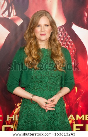 LOS ANGELES, CA - NOVEMBER 18: Writer Suzanne Collins arrives at the premiere of The Hunger Games: Catching Fire at the Nokia Theater in Los Angeles, CA on November 18, 2013 - stock photo