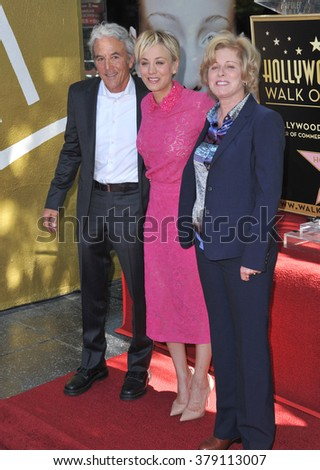 LOS ANGELES, CA - OCTOBER 29, 2014: Actress Kaley Cuoco with her parents on Hollywood Boulevard where she was honored with the 2,532nd star on the Hollywood Walk of Fame. - stock photo