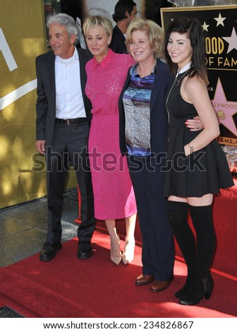 LOS ANGELES, CA - OCTOBER 29, 2014: Actress Kaley Cuoco with her parents & sister on Hollywood Boulevard where she was honored with the 2,532nd star on the Hollywood Walk of Fame.  - stock photo