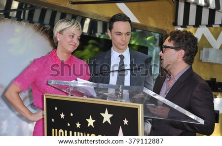 LOS ANGELES, CA - OCTOBER 29, 2014: Actress Kaley Cuoco with  Jim Parsons & Johnny Galecki on Hollywood Boulevard where she was honored with the 2,532nd star on the Hollywood Walk of Fame. - stock photo