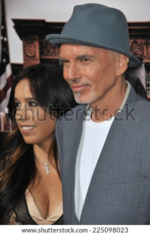 "LOS ANGELES, CA - OCTOBER 1, 2014: Billy Bob Thornton & Connie Angland at the Los Angeles premiere of his movie ""The Judge"" at the Samuel Goldwyn Theatre, Beverly Hills.  - stock photo"