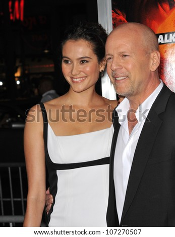 """LOS ANGELES, CA - OCTOBER 11, 2010: Bruce Willis & wife Emma Heming at the premiere of his new movie """"Red"""" at Grauman's Chinese Theatre, Hollywood. - stock photo"""