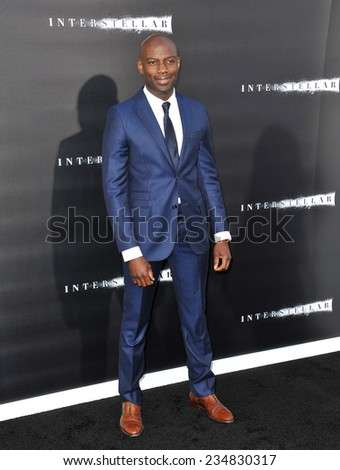 LOS ANGELES, CA - OCTOBER 26, 2014: David Gyasi at the Los Angeles premiere of his movie Interstellar at the TCL Chinese Theatre, Hollywood.  - stock photo
