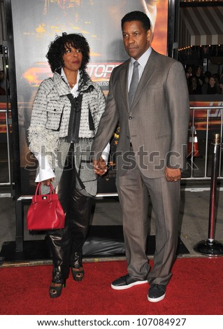 "LOS ANGELES, CA - OCTOBER 26, 2010: Denzel Washington & wife Paulette Washington at the world premiere of his new movie ""Unstoppable"" at the Regency Village Theatre, Westwood. - stock photo"