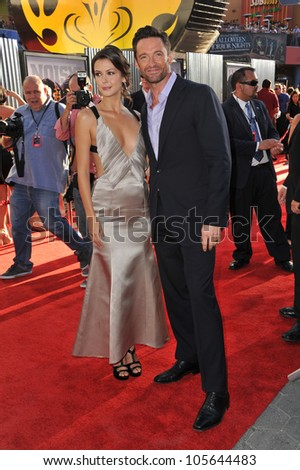 "LOS ANGELES, CA - OCTOBER 2, 2011: Hugh Jackman & Olga Fonda at the Los Angeles premiere of their new movie ""Real Steel"" at Universal Studios Hollywood. October 2, 2011  Los Angeles, CA - stock photo"