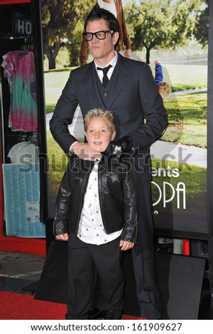 """LOS ANGELES, CA - OCTOBER 23, 2013: Johnny Knoxville & Jackson Nicoll at the premiere of their movie """"Jackass Presents: Bad Grandpa"""" at the TCL Chinese Theatre, Hollywood.  - stock photo"""
