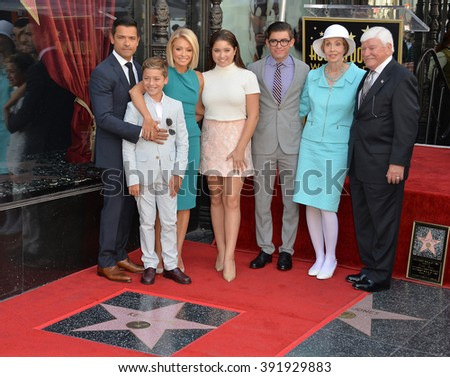 LOS ANGELES, CA - OCTOBER 12, 2015: Kelly Ripa & actor husband Mark Consuelos & children Joaquin, 12, Michael 18, & Lola, 14, & Kelly's parents on Hollywood Walk of Fame. - stock photo