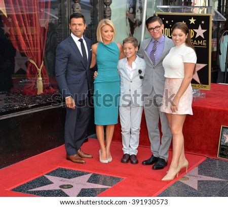 LOS ANGELES, CA - OCTOBER 12, 2015: Kelly Ripa & actor husband Mark Consuelos & children Joaquin, 12, Michael 18, & Lola, 14, at her Hollywood Walk of Fame star ceremony. - stock photo