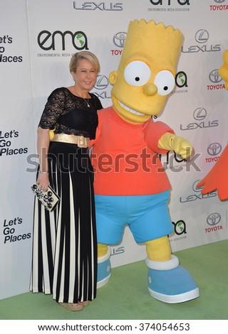 LOS ANGELES, CA - OCTOBER 24, 2015: Simpson's voice actress Yeardley Smith & Bart Simpson character at the 25th Annual Environmental Media Awards at Warner Bros. Studios, Burbank, CA.  - stock photo