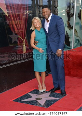 LOS ANGELES, CA - OCTOBER 12, 2015: TV personality Kelly Ripa with Michael Strahan on Hollywood Boulevard where she was honored with the 2,561st star on the Hollywood Walk of Fame.  - stock photo