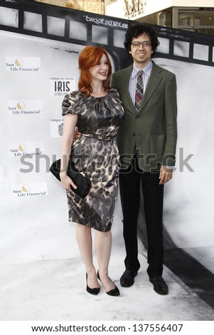 LOS ANGELES, CA - SEP 25: Christina Hendricks; Geoffrey Arend at the IRIS, A Journey Through the World of Cinema by Cirque du Soleil premiere September 25, 2011 at Kodak Theater in Los Angeles, CA - stock photo