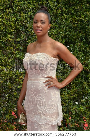 LOS ANGELES, CA - SEPTEMBER 12, 2015: Aisha Tyler at the Creative Arts Emmy Awards 2015 at the Microsoft Theatre LA Live.  - stock photo