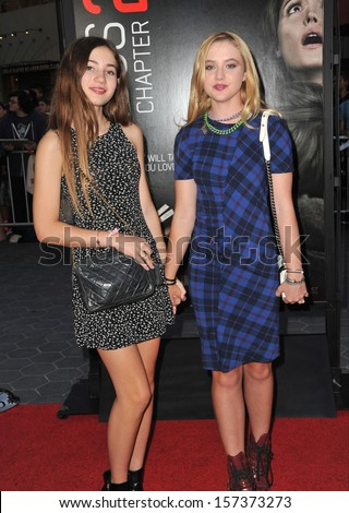 """LOS ANGELES, CA - SEPTEMBER 10, 2013: Georgica Pettus (left) & Kathryn Newton at the world premiere of """"Insidious Chapter 2"""" at Universal Citywalk, Hollywood.  - stock photo"""