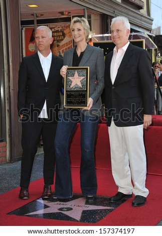 LOS ANGELES, CA - SEPTEMBER 4, 2013: Glee star Jane Lynch with Christopher Guest (right) & Ryan Murphy on Hollywood Blvd where she was honored with the 2,505th star on the Hollywood Walk of Fame.  - stock photo