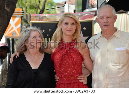"""LOS ANGELES, CA - SEPTEMBER 24, 2015: """"Homeland"""" star Claire Danes & parents Carla Danes & Christopher Danes honored with the 2,559th star on the Hollywood Walk of Fame. - stock photo"""