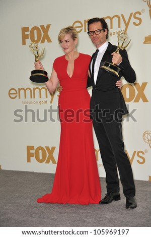 LOS ANGELES, CA - SEPTEMBER 18, 2011: Kate Winslet & Guy Pearce at the 2011 Primetime Emmy Awards at the Nokia Theatre L.A. Live. September 18, 2011  Los Angeles, CA - stock photo