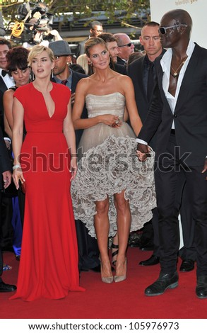 LOS ANGELES, CA - SEPTEMBER 18, 2011: Kate Winslet (left) with Heidi Klum & Seal at the 2011 Primetime Emmy Awards at the Nokia Theatre, L.A. Live. September 18, 2011  Los Angeles, CA - stock photo