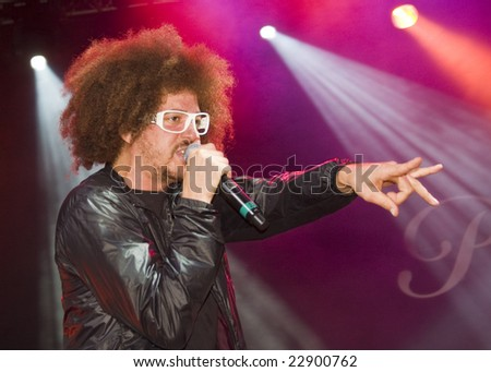 LOS ANGELES, CA - SEPTEMBER 27: Singer Redfoo of LMFAO performs live at Paramount Rocks in Los Angeles, California on September 27, 2008. - stock photo