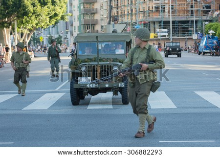 Los Angeles, CA - USA - August 16, 2015:  World War II military vehicle with veterans during 75th Annual Nisei Week Grand Parade in Little Tokyo. - stock photo