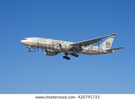 LOS ANGELES, CA/USA - JANUARY 24, 2016: Etihad  aircraft (Boeing 777) shown approaching LAX. Etihad Airways is a flag carrier and the second-largest airline of the United Arab Emirates. - stock photo