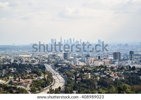 Los Angeles, CA, USA . January 16, 2016: View of the los angele. Good sunny day in downtown Los Angeles, California. Aerial view of Los angeles city from Runyon Canyon park Mountain View - stock photo