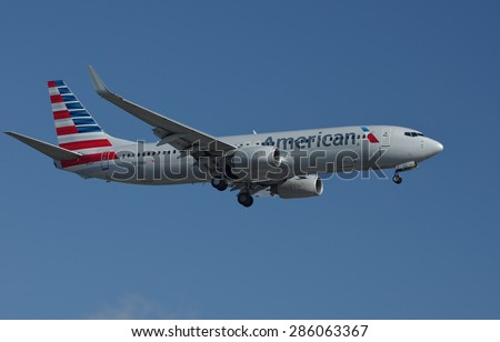 LOS ANGELES, CA/USA - JUNE 5, 2015: American Airlines aircraft (Boeing 737 Next Generation, reg N813NN) shown shortly before landing at the Los Angeles World Airport (LAX). - stock photo